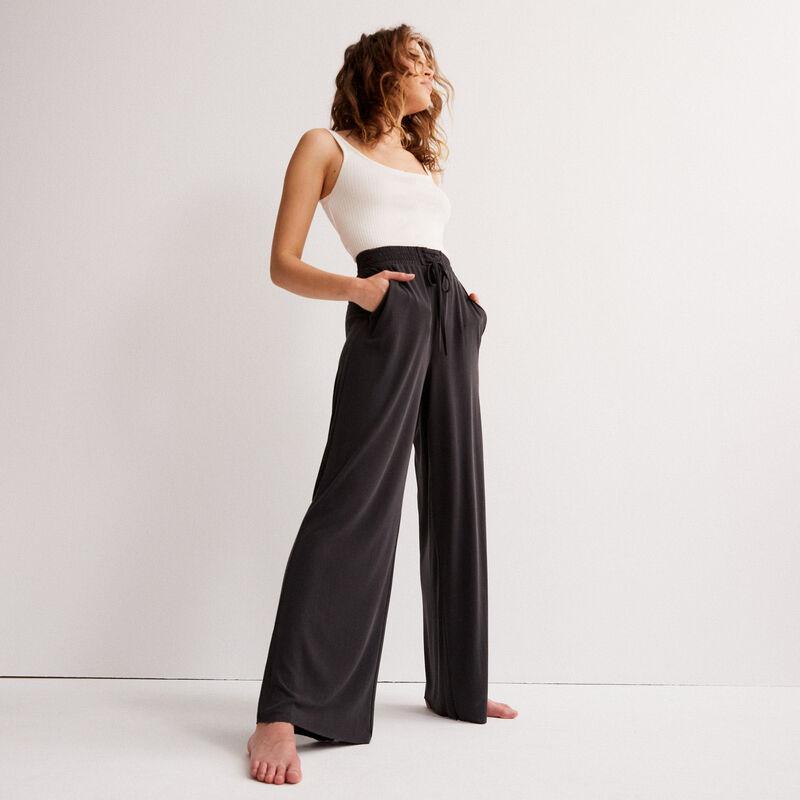 Wijde broek met perzikhuid effect - zwart;